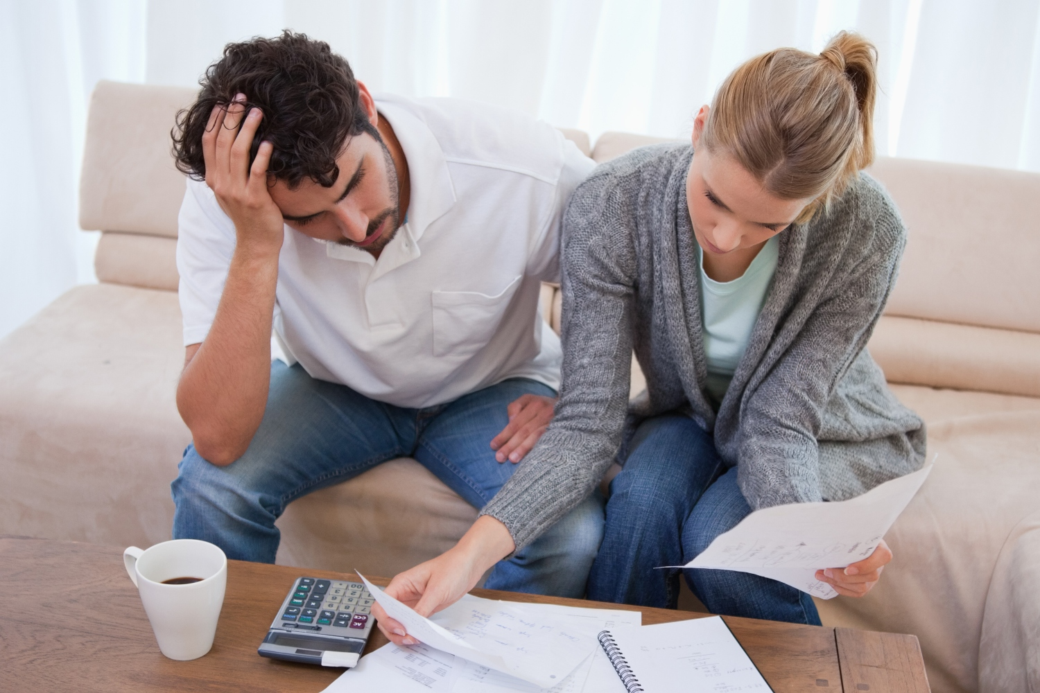 Business owner reviewing finances with spouse