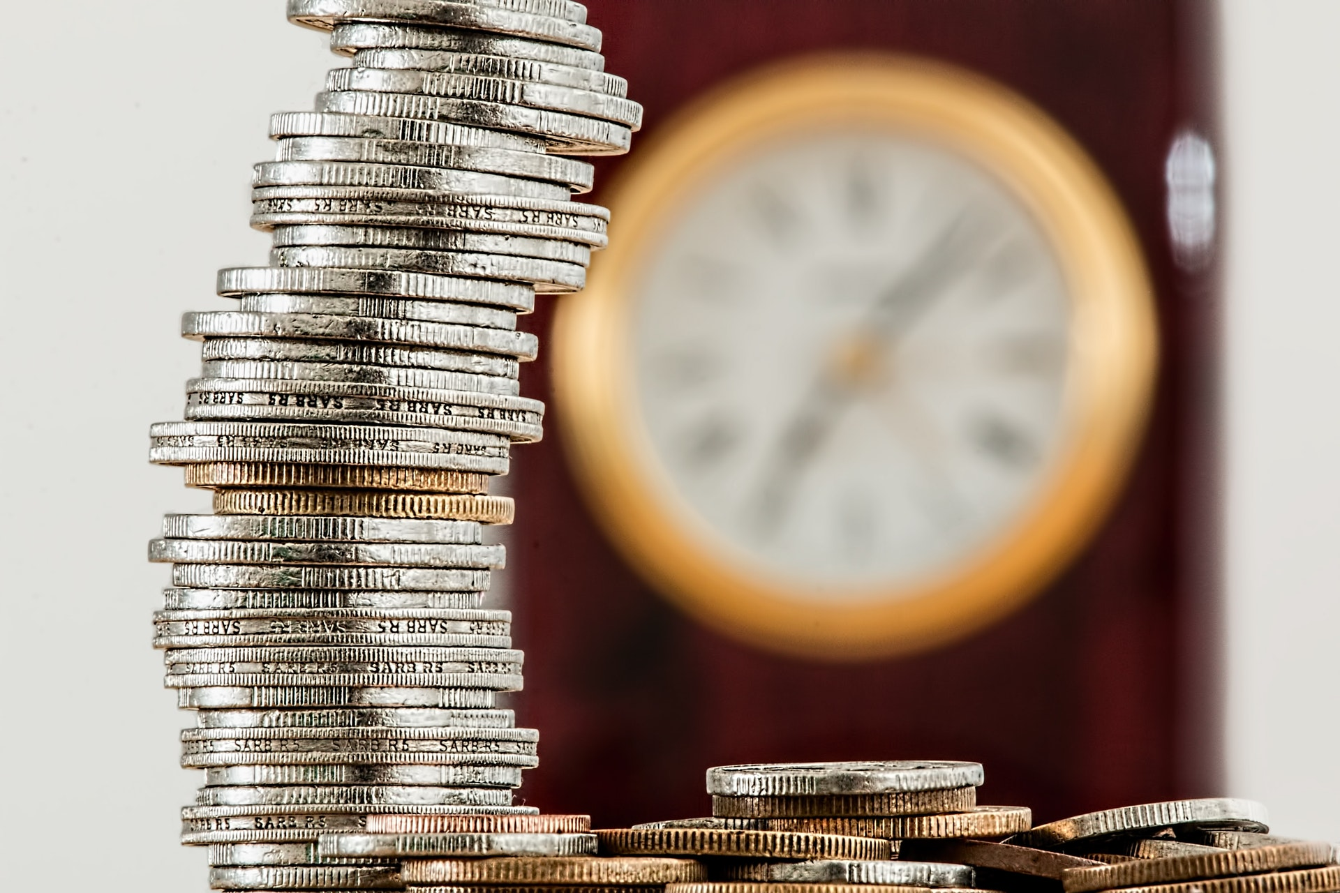 Coins stacked with clock